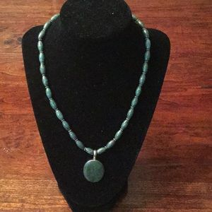 Handcrafted jade and sterling necklace.